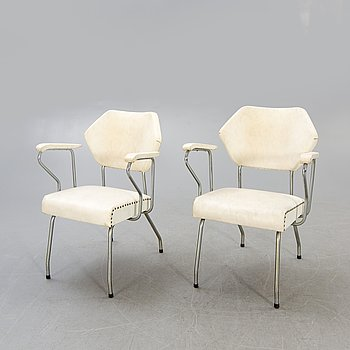 A pair of 1950s armchairs.