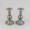 A pair of pewter candle holders by edvin ollers, 1952.