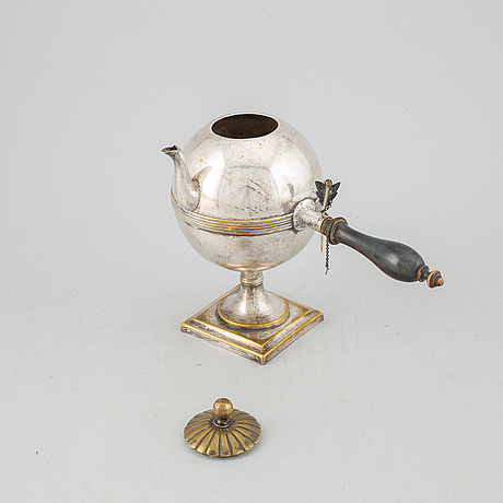 An empire 19th century silvered brass teapot.