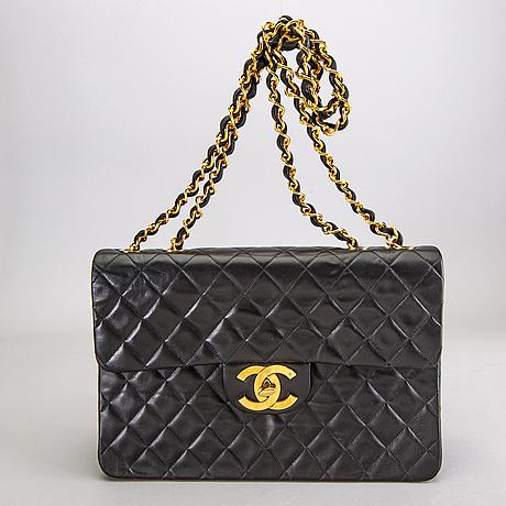 A chanel maxi jumbo leather bag.