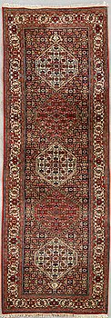 An old Bidjar runner signed and dated 320x88 cm.