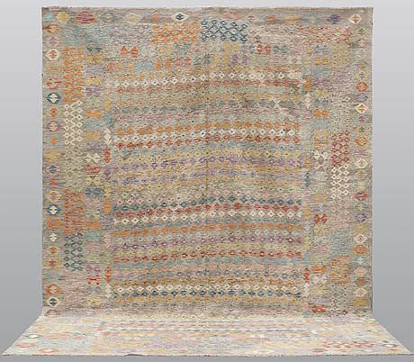 A carpet, kilim, 390 x 314 cm.