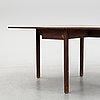 A mahogany gate-legged table, england, around the year 1800.