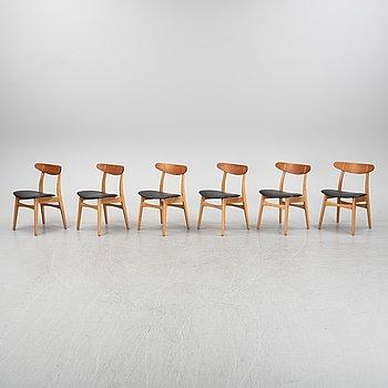 Hans J Wegner, a set of six CH-23 chairs, Carl Hansen & Son, Odense, Denmark.