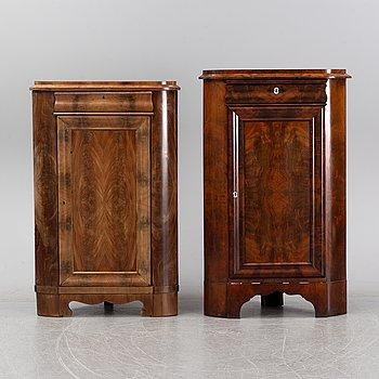 A pair of mahogany corner cabinets, mid 19th Century.