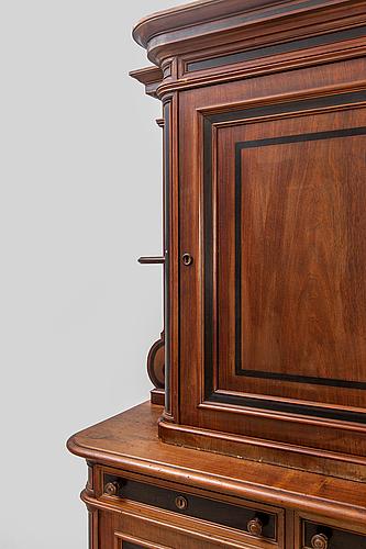 An early 1900s walnut cabinet.