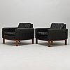 Jussi peippo, a pair of 1960s leather upholstered armchairs, asko. design year 1962.