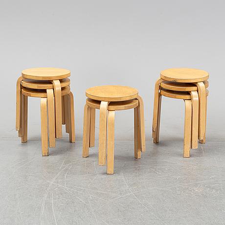 Alvar aalto, a set of eight model 60 birch stools for artek, finland.