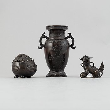 A Chinese bronze vase, figurine and censer, late Qing dynasty.