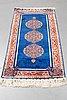 A rug, silk hereke, ca 143 x 63,5 cm.
