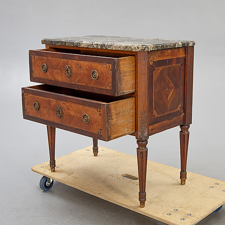 A louis xvi style mahogany hest of drawers around 1900.