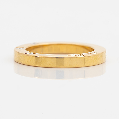 Efva attling, ring, 'high & i love you on the side' 18k gold with princess cut diamonds.