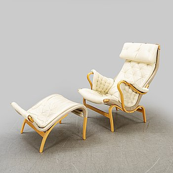 """Bruno Mathsson, a """"Pernilla"""" easy chair with footstool."""