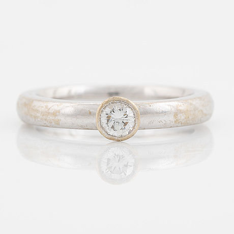 A solitaire brilliant cut diamond ring.