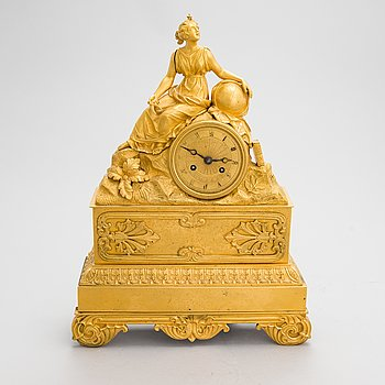 A French Empire mantel clock from 1820s-30s.