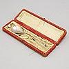 A silver spoon in a box, ottoman empire, around 1900.