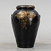 A 20th century earhten ware urn.