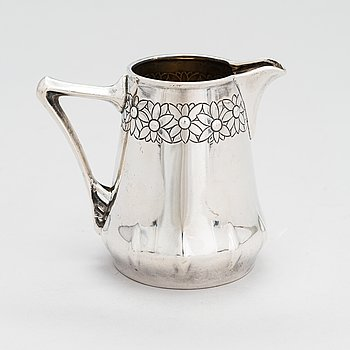 An early 20th-century German Jugend style silver cream jug.