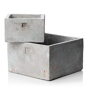 A pair of contemporary concrete flower pots.