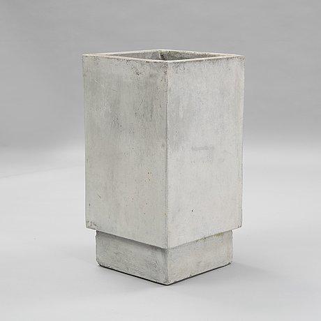 A contemporary concrete flowerpot.