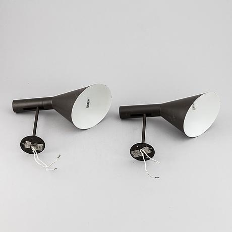 Arne jacobsen, a pair of 'aj'-wall lights, louis poulsen, denmark, designed 1959.