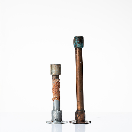 Two 20th century industrial design metal/copper pipe candlesticks.