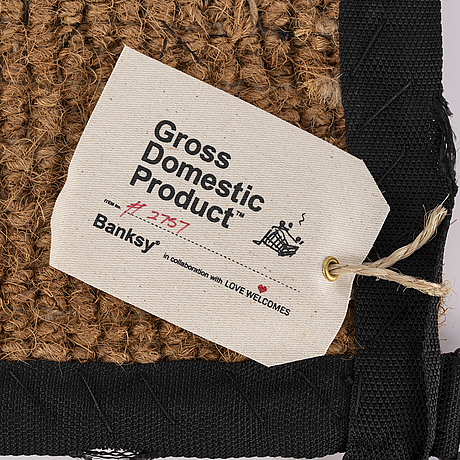 Banksy, hand-stitched doormat using the fabric from life vests, 2019.