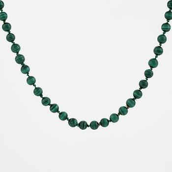 A malachite necklace.