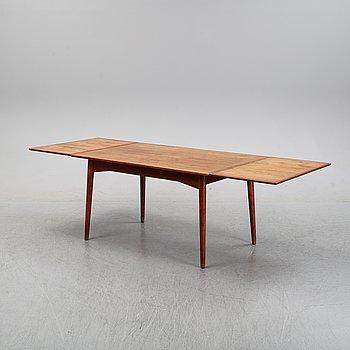 A teak dining table, 1950's/60's.