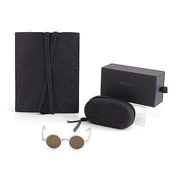 A pair of Uma Wang + Rigards, 'The Victorian', sunglasses and a Uma Wang, ipad case.