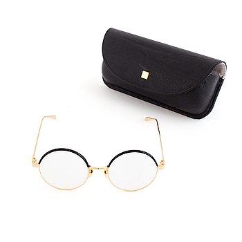 A pair of Linda Farrow glasses.