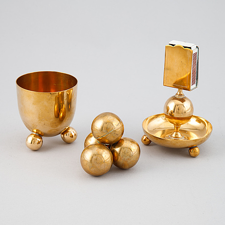 A brass desktop set, mostly gusums bruk (12 pieces).