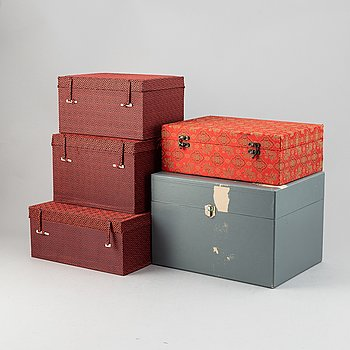 A group of five Chinese fabric clad boxes.
