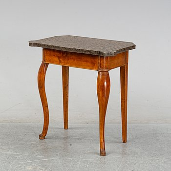 An early 20th Century composite birch table with a stone top.