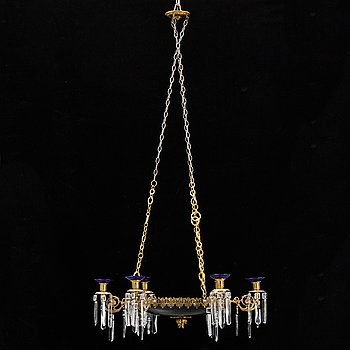 A tin and brass chandelier, 20th Century.