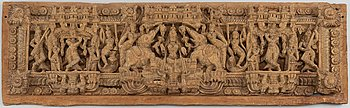 A carved wooden panel, India, circa 1900.