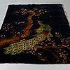 A rug, a semi-antique baotou figural, ca 206 x 135 cm.