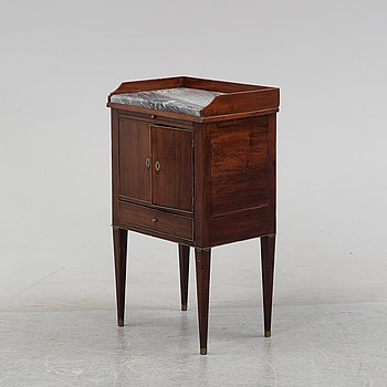 A late Gustavian mahognay bedside cabinet with a stonetop, early 19th Century.
