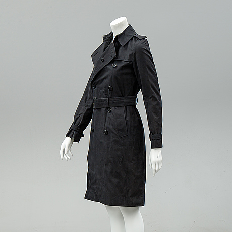 Burberry, a black trench coat, size 32.