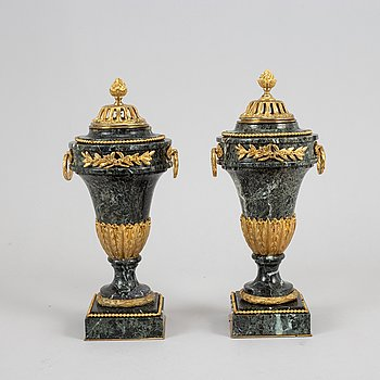 A pair of marble and gilt bronze decorative urns, Louis XVI-style, late 19th Century.