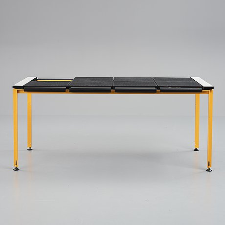 A 20th century lacquered metal desk.