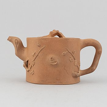 A Yixing pottery tea pot with cover, China, 20th Century, with seal mark.