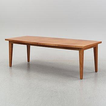 A 'Wood U-2' cherrywood dining table by Henrik Bonnelycke, Denmark, around the year 2000.