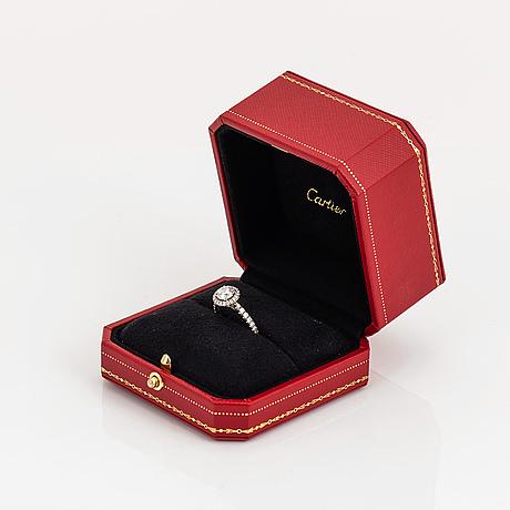 Cartier,  ring med rund briljantslipad diamant, 1,04 carat. gia certifikat.