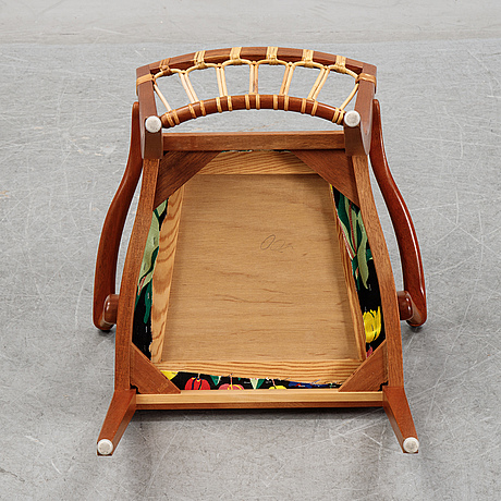 A mahogany model 1165 armchair by josef frank for frima svenskt tenn.