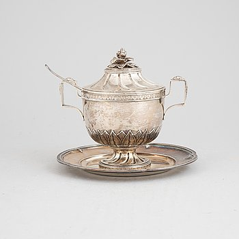 A Gustavian style sugar bowl on a plate with spoon, 1904-1905.