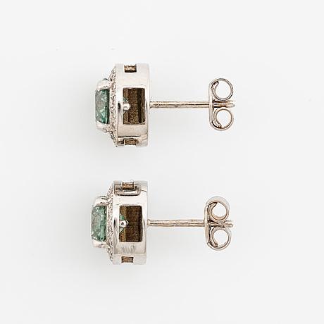 Colour treated brilliant cut diamond earrings.