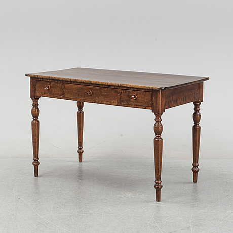 An early 20th century birch writing desk.