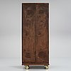 A 20th century patinated metal changing room cabinet.