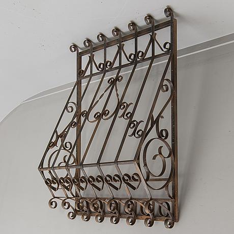 A cast iron window gate 20th century.